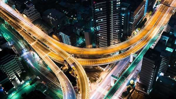Multi-hour aerial view timelapse of a massive highway intersection at night in Shinjuku, Tokyo, Japan. Royalty-free stock video
