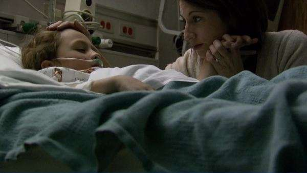 Mother comforting child in hospital bed Royalty-free stock video
