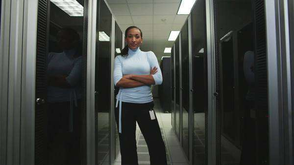 Woman standing in a server room Royalty-free stock video