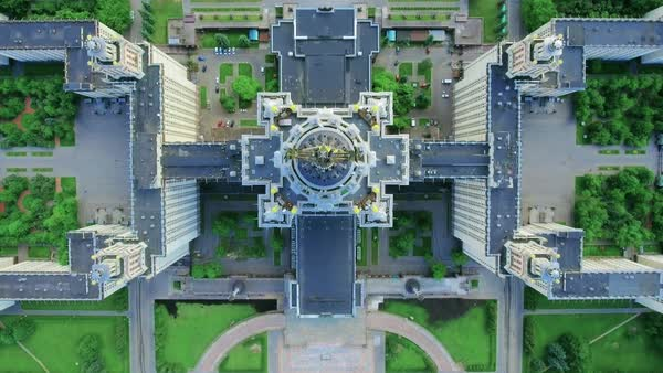 Top view of the main building of Moscow State University and the adjacent territory in a summer sunny day in good weather. Flight over the spire of MSU. Royalty-free stock video