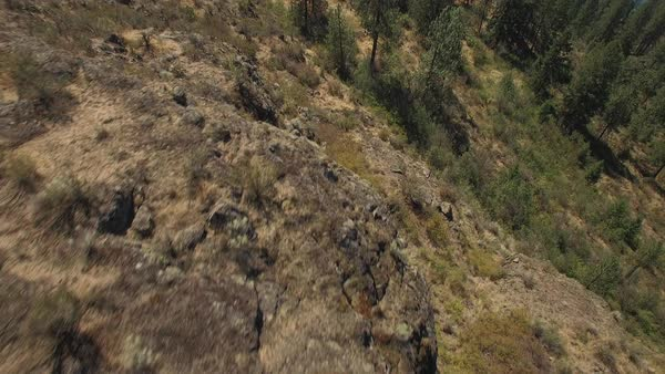 Drone Pilot Flying with Remote on Top of Rocky Mountain Cliff Royalty-free stock video