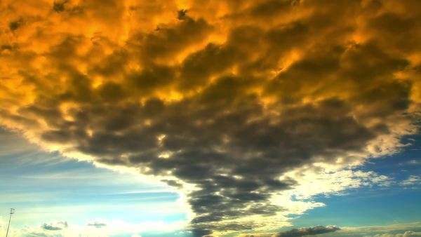 Timelapse of orange clouds in summer in blue sky with sun Royalty-free stock video