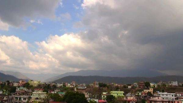 Timelapse in city of stormy clouds with mountains Royalty-free stock video