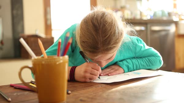 9 Year Old Coloring Books : Close up of 9 year old girl drawing in coloring book stock video