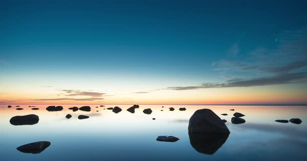 Day to night timelapse of a calm sea and a stony beach with big rocks on the island of Vormsi, Estonia Royalty-free stock video