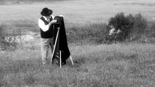 40s era photographer in a large open field taking photos black and white version Royalty-free stock video