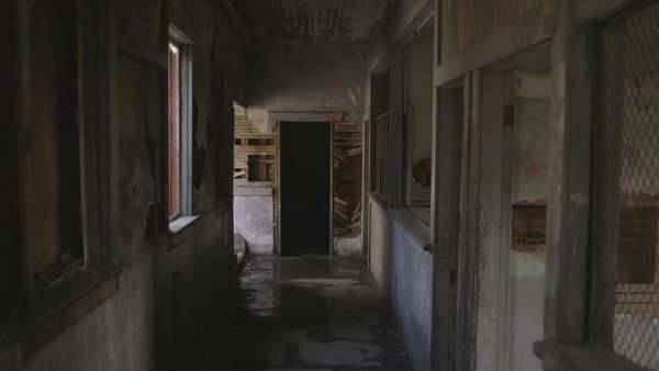 Wide shot of a corridor in an abandoned factory Royalty-free stock video