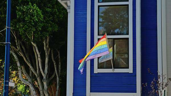 SAN FRANCISCO - October, 2015 - A gay pride flag flies outside a residence near the Castro District in San Francisco.    Royalty-free stock video