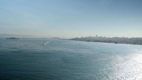 An extreme daytime wide shot of the San Francisco Bay with Alcatraz Island the  city of San Francisco in the background.  	 Royalty-free stock video
