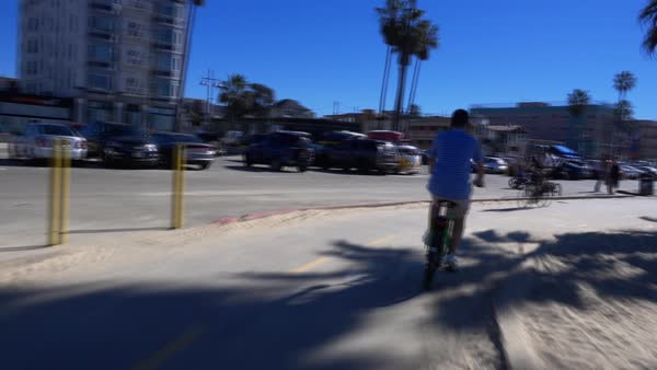 VENICE BEACH, CA - Circa February, 2016: A fast time lapse view of riding bikes on Venice Beach.  	 Royalty-free stock video