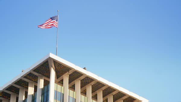 The American flag at the top of the Bank of America building in Beverly Hills.  	 Royalty-free stock video