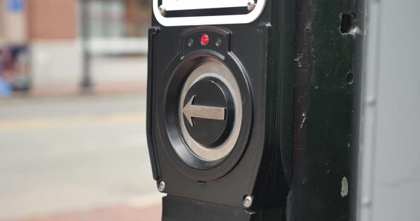 A close-up shot of a Boston pedestrian pressing the crosswalk button.    Royalty-free stock video
