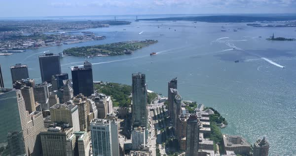 A unique high angle time lapse view of Lower Manhattan and Battery Park with Governors Island and the Verrazano-Narrows Bridge in the distance.  	 Royalty-free stock video