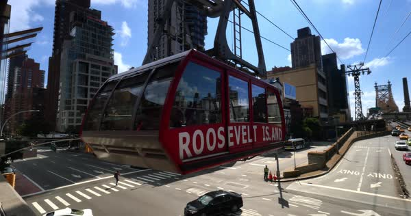 NEW YORK - Circa July, 2016 - An establishing shot of the Roosevelt Tramway leaving the station in Manhattan.  	 Royalty-free stock video