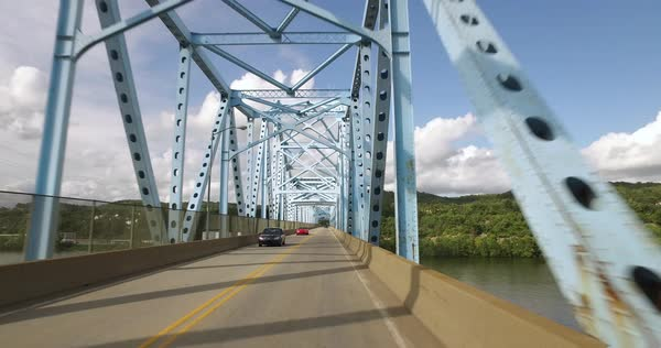 A driver's perspective of driving on a typical two-lane bridge over the Ohio River in Western Pennsylvania. Royalty-free stock video