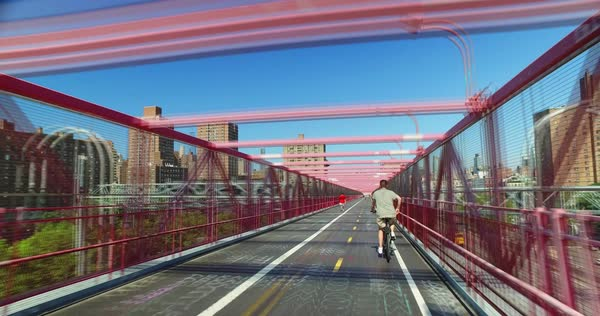 A timelapse perspective view as seen while on the pedestrian sidewalk on the Williamsburg Bridge.  	 Royalty-free stock video