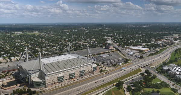 An aerial view over the Alamodome and Interstate 37 in San Antonio, Texas.  	 Royalty-free stock video