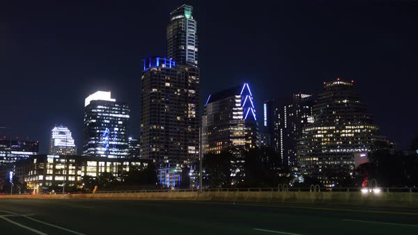 A nighttime time lapse view of traffic on the South 1st Street Bridge in downtown Austin, Texas.  	 Royalty-free stock video