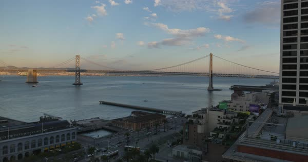 An evening sunset time lapse over the San Francisco Bay Bridge.	 	 Royalty-free stock video