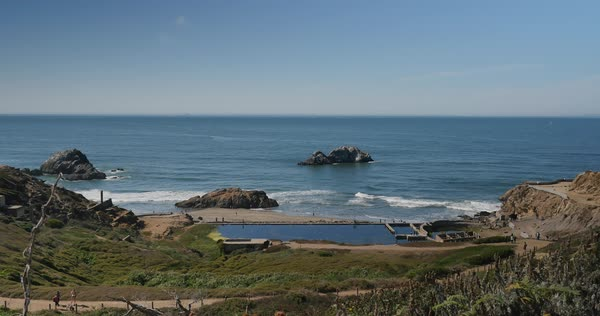 A daytime sunny establishing shot of Sutro Baths in San Francisco.  	 Royalty-free stock video