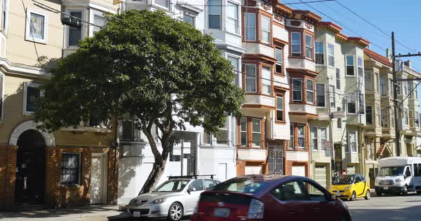 An establishing shot of typical San Francisco homes or apartment buildings.	 	 Royalty-free stock video