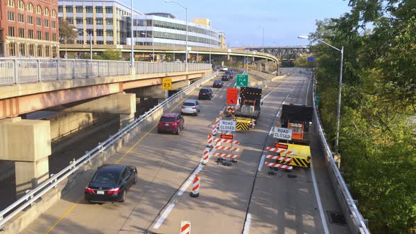 Traffic gets detoured in downtown Pittsburgh due to a closed road.  	 Royalty-free stock video