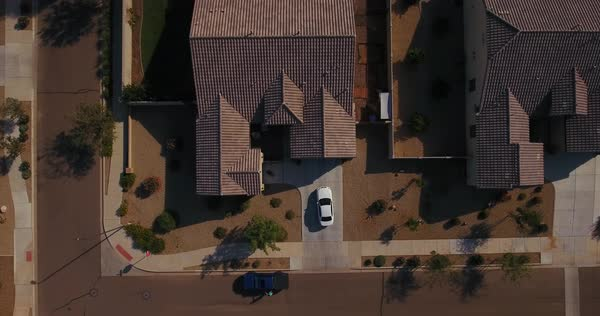 A unique aerial view of a car pulling out of a typical Arizona neighborhood residence. Phoenix suburb.  	 Royalty-free stock video