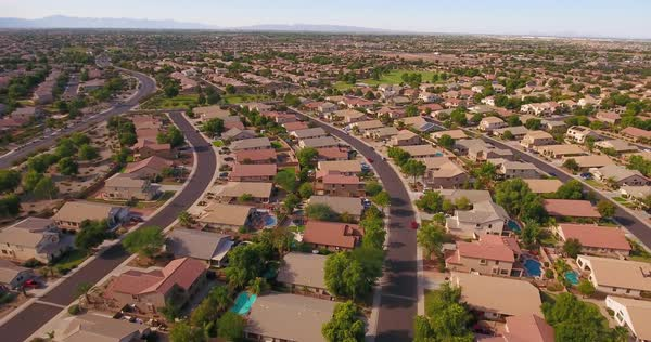 A flyover aerial establishing shot of a typical Arizona residential neighborhood. Phoenix suburb.	 	 Royalty-free stock video