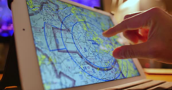 A pilot examines VFR maps of the Pittsburgh area on a tablet before a flight. Royalty-free stock video