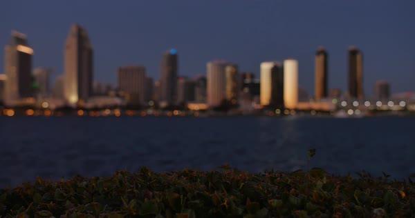 SAN DIEGO, CA - Circa February, 2017 - A picturesque defocused slow dollying establishing shot of the San Diego skyline at dusk. Royalty-free stock video