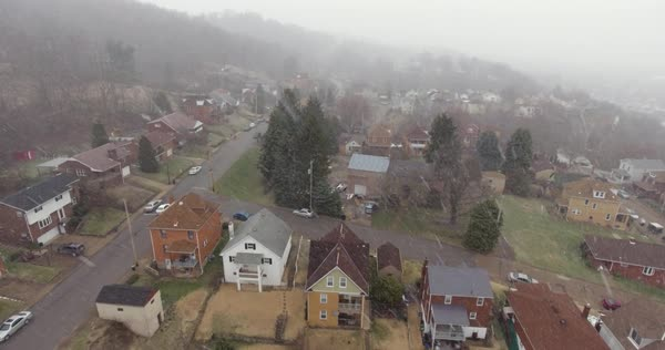 A slowly moving forward aerial snowy winter view of a typical Western Pennsylvania residential neighborhood. Royalty-free stock video