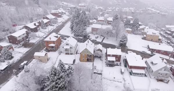 A slowly moving forward aerial snowing winter view of a typical Western Pennsylvania rust belt residential neighborhood. Royalty-free stock video