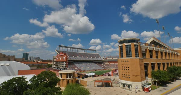 AUSTIN, TX - Circa September, 2016 - A day timelapse establishing shot of the University of Texas Longhorns stadium.  Royalty-free stock video