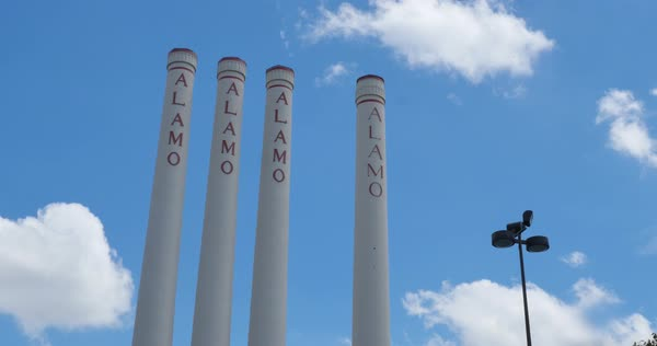 SAN ANTONIO, TX - Circa September, 2016 - A timelapse view of smokestacks at the Alamo Quarry Market on a sunny day.  Royalty-free stock video