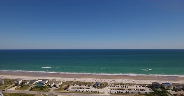 A slowly rising aerial view of Topsail Island beach during the day. Royalty-free stock video