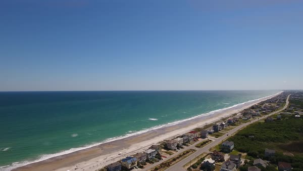 A high angle aerial daytime establishing shot of Topsail Island, North Carolina. Royalty-free stock video
