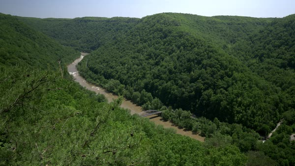 A high angle summer establishing shot of the New River Gorge in West Virginia. Royalty-free stock video