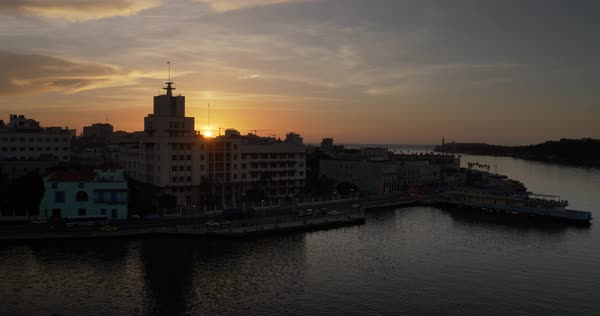 A wide establishing shot of the sun setting over Havana, Cuba.  Royalty-free stock video