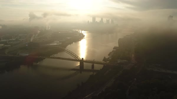 A cinematic reverse aerial view of the Pittsburgh skyline on an early autumn foggy morning.   Royalty-free stock video