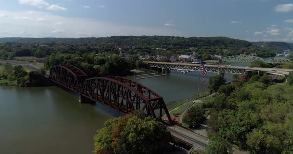 A high angle forward aerial view of a small Western Pennsylvania town on the Ohio River.   Royalty-free stock video
