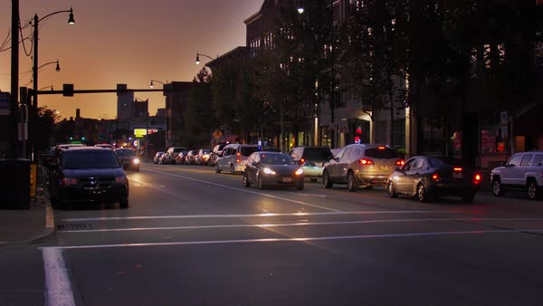 An evening sunset establishing shot of traffic and buildings along East Carson Street in Pittsburgh's South Side district.   Royalty-free stock video
