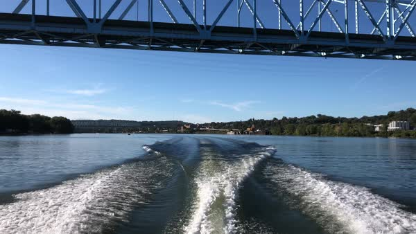 A rear view of the wake from the back of a motorboat on the Ohio River.   Royalty-free stock video