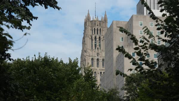 A daytime establishing shot of the tower on The Riverside Church in upper Manhattan.  Royalty-free stock video