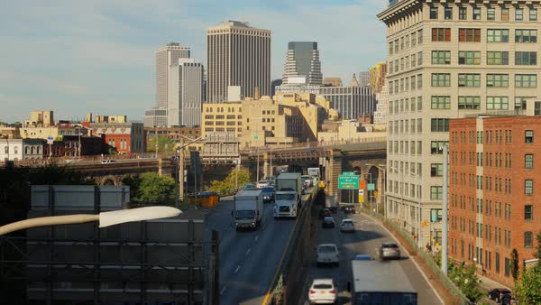 A daytime high angle view of traffic on Brooklyn Queens Expressway on a sunny autumn day.   Royalty-free stock video