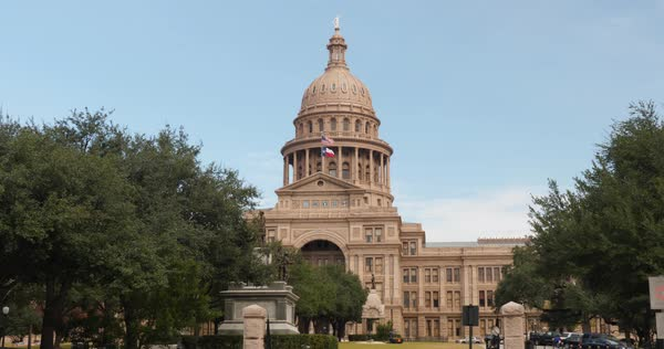 A daytime exterior (DX) establishing shot of the Texas state capitol building in Austin, Texas. Day/night matching available.  Royalty-free stock video