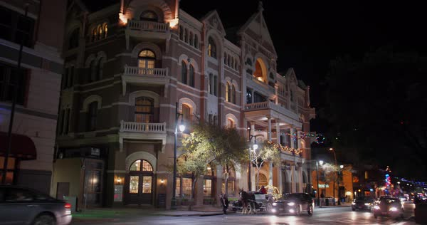 AUSTIN, TX - Circa December, 2017 - A nighttime establishing shot of The Driskill Hotel in the historic district of Austin, Texas decorated for Christmas. Royalty-free stock video