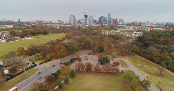 A daytime overcast aerial view of the Austin, Texas skyline from Zilker Metropolitan Park.  Royalty-free stock video