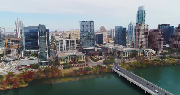 A slow forward high aerial establishing shot of the Austin, Texas skyline on a late Fall overcast day.   Royalty-free stock video
