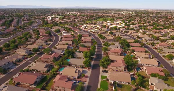 An aerial establishing shot of a typical Phoenix, Arizona residential neighborhood with WiFi hotspot markers over random homes Royalty-free stock video