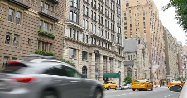 An establishing shot of a row of typical New York style apartment building overlooking Central Park. Royalty-free stock video